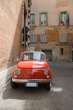 Small Old Fiat 500 Car Parked On A Back Street In Rome, Lazio