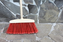 Classic Broom Close Up On A Stone Background