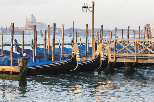 Gondals moored at waterfront, Riva degli Schiavoni, with view to San Giorgio Maggiore, Venice, UNESCO World Heritage Site, Veneto, Italy, Europe