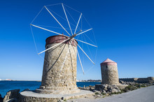 Medieval Windmills At Mandraki Harbour, City Of Rhodes, Rhodes, Dodecanese Islands, Greek Islands, Greece