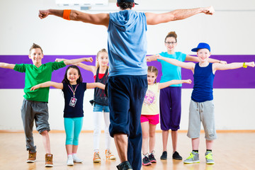Dance teacher giving kids Z...