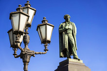 Iron Lantern On The Background Of The Monument To Alexander Push
