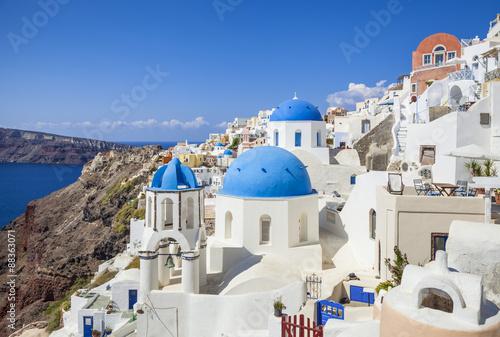 Papiers peints Santorini Greek church with three blue domes in the village of Oia, Santorini (Thira), Cyclades Islands, Greek Islands, Greece, Europe