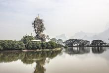 Small Pagodas On A Steep Rock