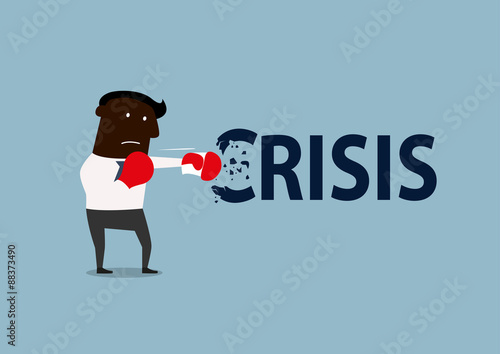 Fotografía  Black businessman boxing with crisis