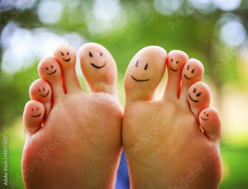 smiley faces on a pair of feet on all ten toes (VERY SHALLOW DOF Wall mural