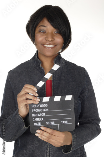 Fotografie, Obraz  An attractive young woman holds an open film slate.