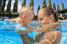 Portrait Of Boy Having Fun In Pool With Joyful Mother. Healthy Lifestyle, Baby Swimming And Diving Underwater Lessons With Active Parents, And Water Sports Activity On Summer Holidays With Children