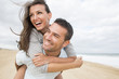 canvas print picture - portrait of living young couple at the beach
