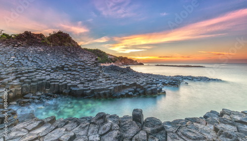 Poster Lavendel Sunrise on Giant Causeway, Phu Yen, Vietnam as the sun radiating aura prepared horizon to catch a beautiful new day