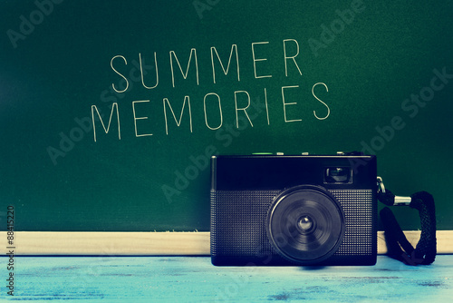 retro camera and the text summer memories, filtered
