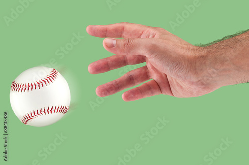 Fotografie, Obraz  A hand throwing a baseball