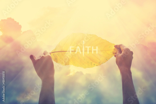 Fotografie, Tablou  abstract, holding a yellow leaf in the clorful sky of faith, vintage tone