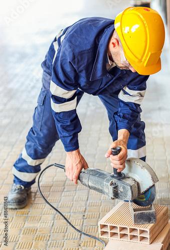 Fotografie, Obraz  Man at work circular saw
