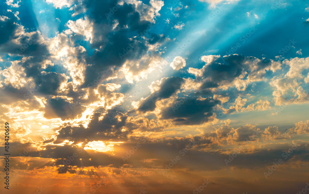 Fototapeta rays of the sun in the clouds