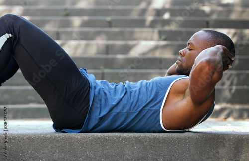 Fotografie, Obraz  Fit african american man doing stomach crunches