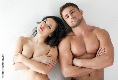 Photo of naked people - sexy girl and muscular guy - Buy this stock