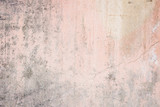Worn pale pink concrete wall texture background with a bit of vignetting, paint partly faded. - 88435038