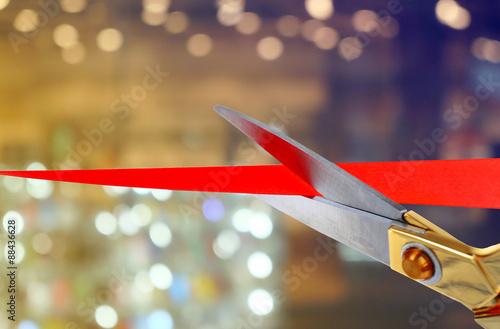 Scissors cutting red ribbon Canvas Print