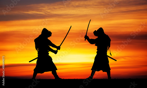 Photo  Silhouette of two samurais in duel.