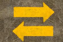 Yellow Traffic Arrow Sign On T...