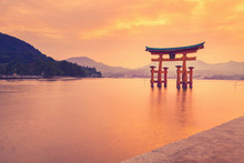 The Famous Orange Shinto Gate (Torii) Of Miyajima Island, Hiroshima Prefecture, Japan.