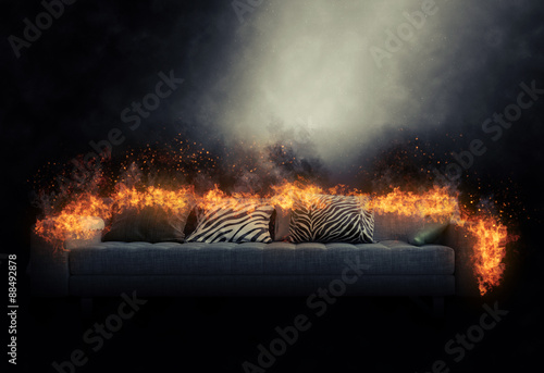 Fotografiet  Sofa engulfed in burning flames