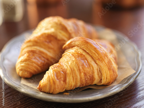 Fotografie, Obraz  two croissants on plate and shot with selective focus
