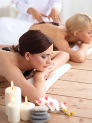 Obraz na płótnie Canvas Two young beautiful women relaxing and enjoying at the spa