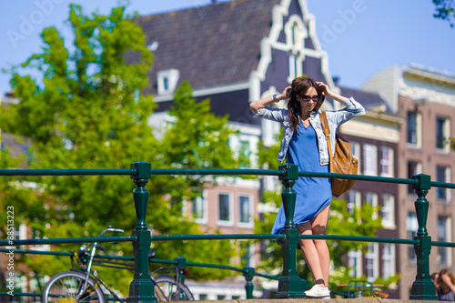 Young beautiful woman walking in european city, Amsterdam Canvas Print