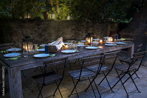 Fotografie, Obraz  large rustic table prepared for a outside dinner at night
