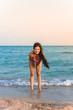 Beautiful girl smiling on the sea