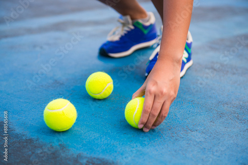 Fotografie, Obraz  Athletes keep the tennis ball on a tennis court