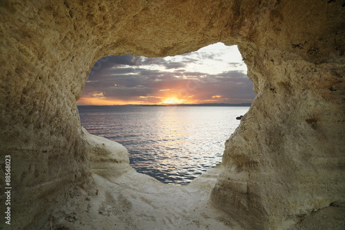 fiery sunset from inside a cave that creates a frame in the shape of heart Poster