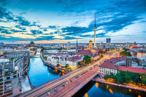 Staande foto Berlijn Berlin skyline panorama with dramatic clouds in twilight at dusk, Germany