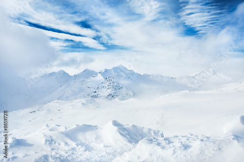 Fototapety, obrazy: Winter snow-covered mountains and blue sky with white clouds