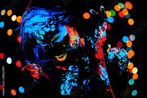 Girl with neon paint bodyart portrait, studio shot