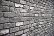 Grey brick wall with diminishing perspective