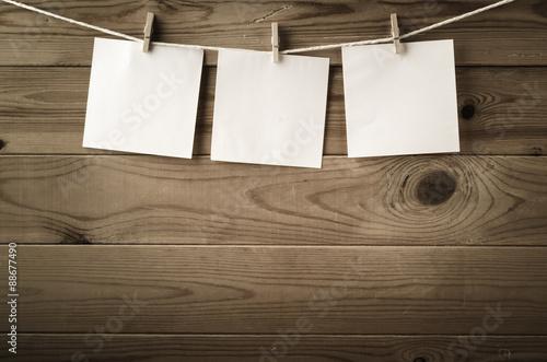 Fotografija  Three Square Reminder Notes Pegged on Clothesline