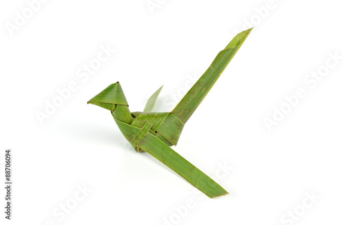 Valokuva  bird made of coconut leaves on white background