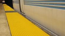 City Subway Train Stops At Platform And Passenger Boards