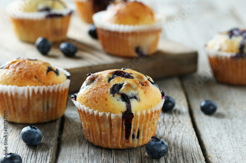 Fotografie, Obraz  Tasty blueberry muffins on a grey wooden background