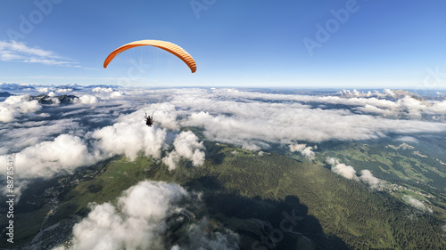 Spoed Fotobehang Luchtsport Two-seater paraglider above the clouds