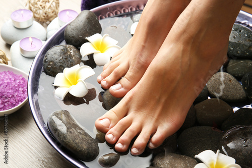 Poster Pedicure Female feet at spa pedicure procedure