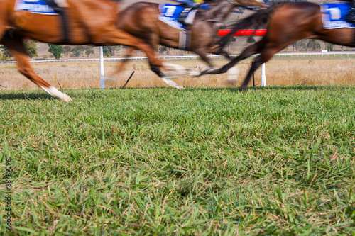 Fotografía Horses race past in a blur with room for copy below
