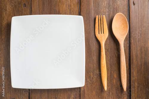 empty dish, Wooden spoon and fork on wooden background