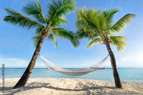 Urlaub am Palmenstrand in der Karibik mit Hängematte Plakat