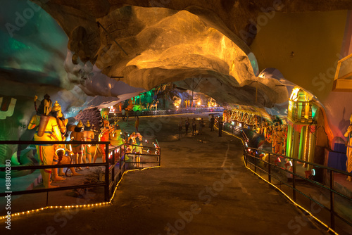 Photo Stands Kuala Lumpur ancient batu caves in malaysia having a hindu temple inside