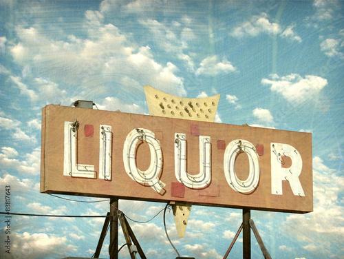 Fotografie, Obraz  aged and worn vintage liquor store sign