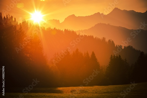 Photo sur Toile Orange eclat Scenic Alps Sunset